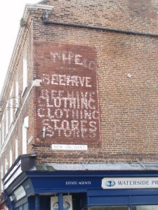 The sign of H.J. Travers' Beehive Stores
